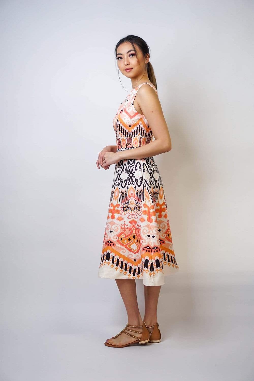 An enlarged tribal print offers a unique take on a classic design. Fit-and-flare shape. Scoop neck and Zip back with hook-and-eye fastening. Keep the look fresh with neutral shoes and accessories and let the print be the star of the show.
