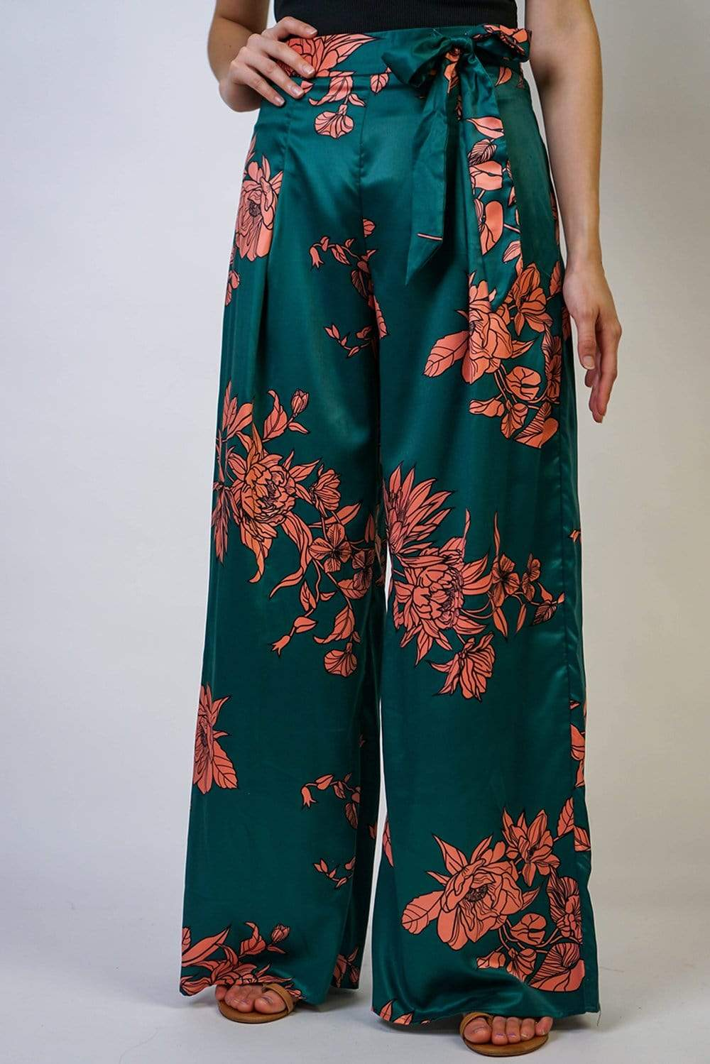 These satin pants are perfect for all kinds of occasions. Featuring an orange and green dragon floral design with a wide-leg design. These are made for a relaxed fit and to give you a slouchy silhouette. High-wasted with a wrap belt. Try yours with the matching wrap top to wear the two piece set.