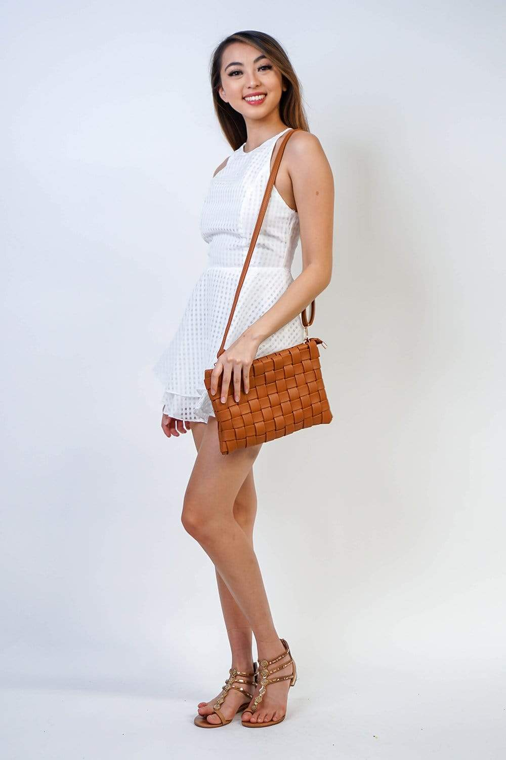 Sleeveless white gingham romper perfect for day outings and cocktail parties. Halter neck and back zipper, with an A-line short that will add movement and dynamic to your look.