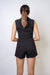 Sleeveless V-neck notch collar tailored black romper. Tight at the waist to accentuate the figure. Perfect for a professional and sexy look.
