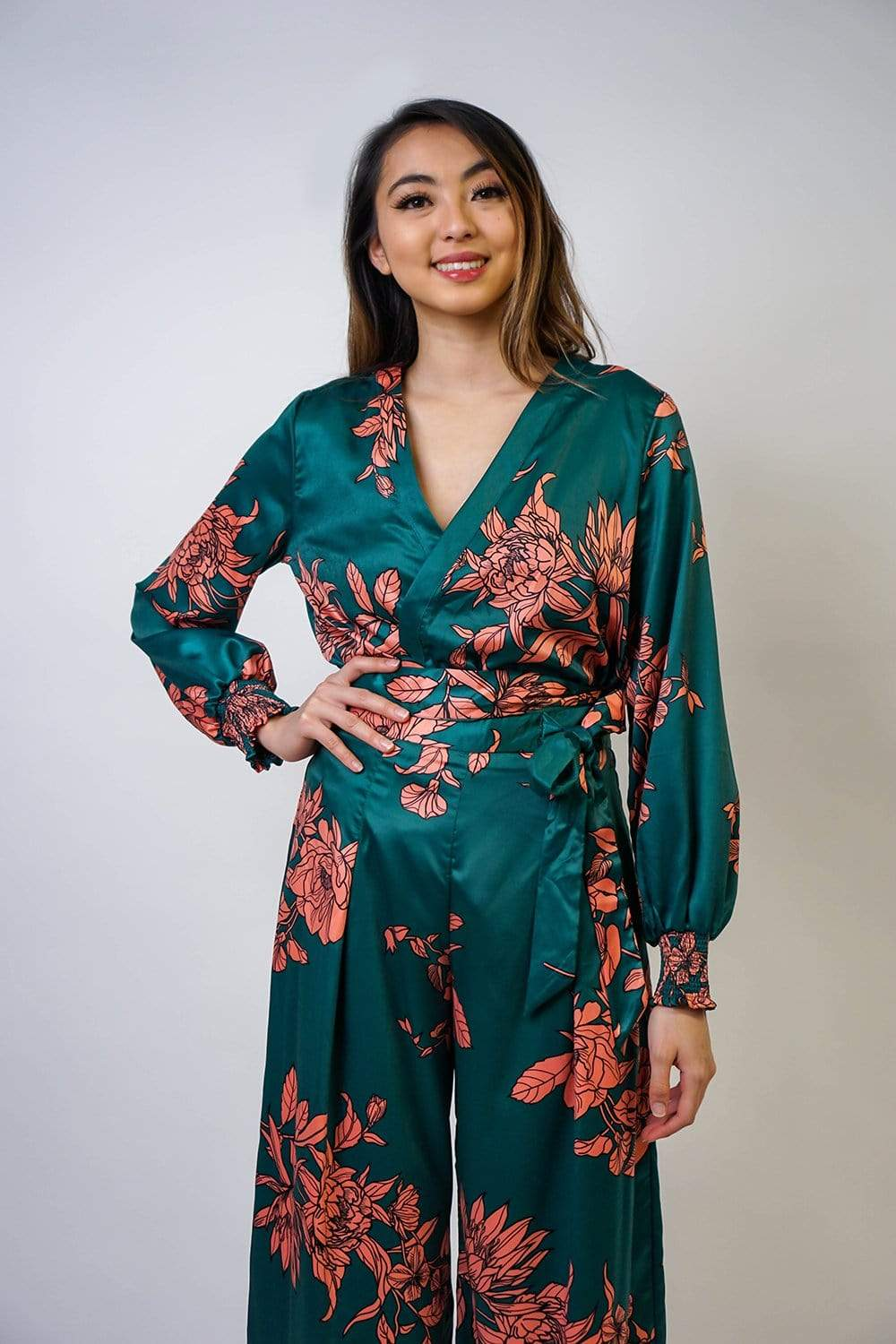 Wrap kimono in green and orange dragon floral satin two-piece. V-neck with  a coordinating self-tie belt to cinch the waist. These are made for a relaxed fit and to give you a slouchy silhouette. Stretchy cuff sleeves. Try yours with the matching wide-leg pants to wear the two piece set.