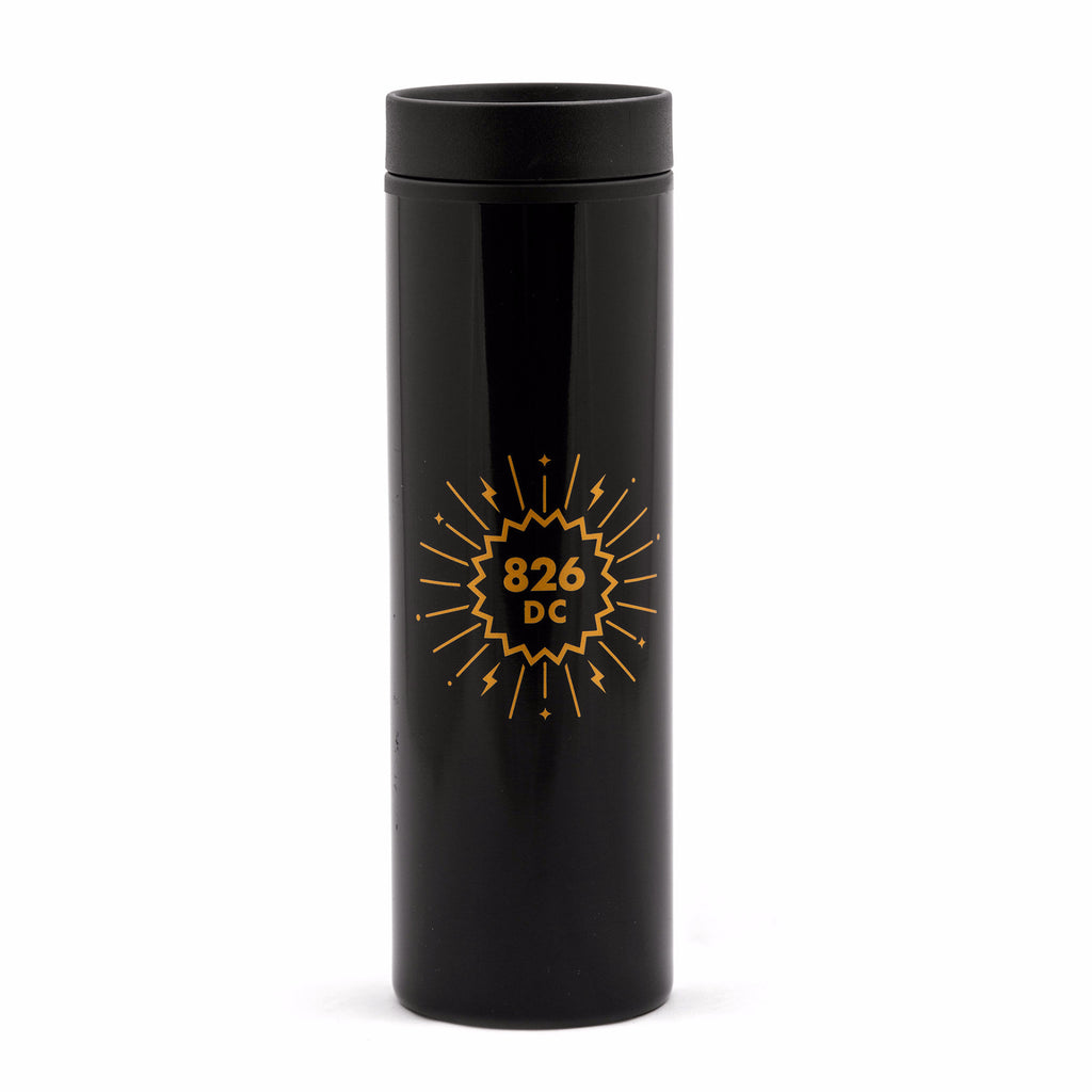 Tall, black plastic travel mug with 826DC logo in gold.