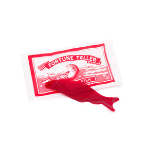 Thin, plastic, transparent red fish that predicts your fortune based on how it folds in your palm.