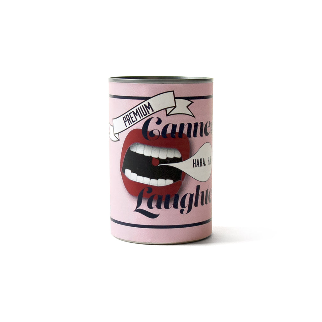 "Soup can covered with a pink label. Open mouth with a quote bubble. ""Canned Laughter"" in sans serif font."