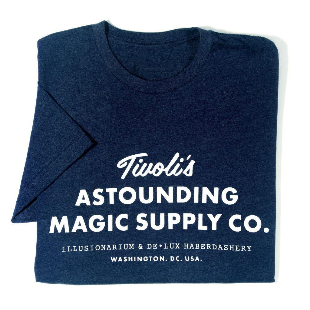 Navy blue shirt with Tivoli's Astounding Magic Supply Co. logo in white.