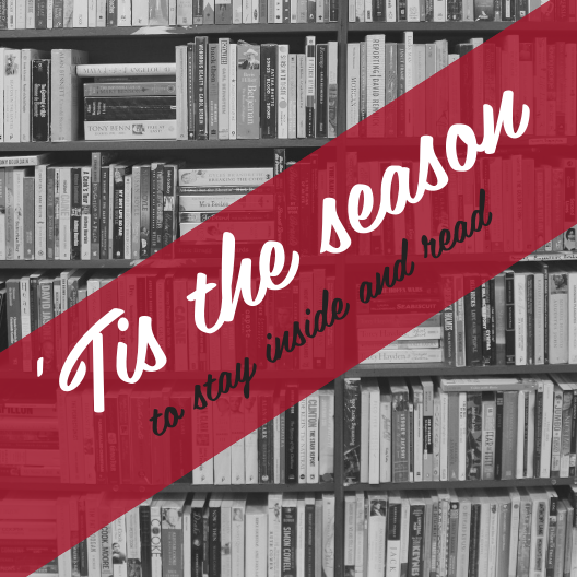 "5"" x 5"" laminated card. Shelves of books in black and white in the background. ""'Tis the season"" in large script white font with ""to stay inside and read"" in black smaller script font, both against a red banner diagonally from the bottom left to top right corners."