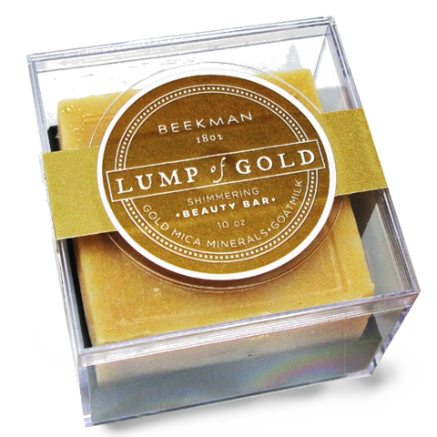 Beekman 1802 Lump of Gold shimmering beauty bar. 10 ounce soap bar made of gold mica minerals and goat milk. Clear box container.