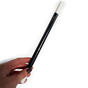 12 inch long magic wand. Black with white tips at both ends.