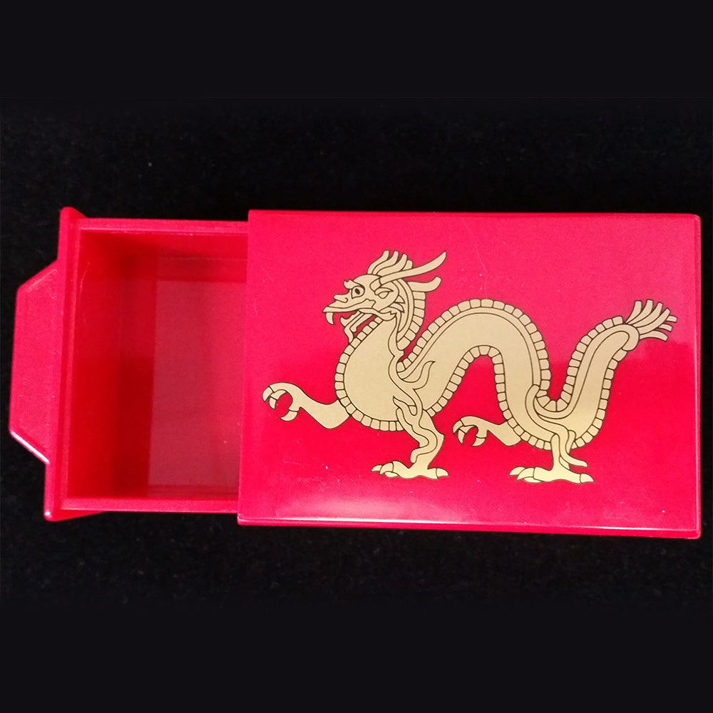 "4.5"" x 3"" x 1.5"" plastic red box with a dragon design on the front. An outer drawer slides out when the back is intact. An inner drawer slides out when the back is shifted out."