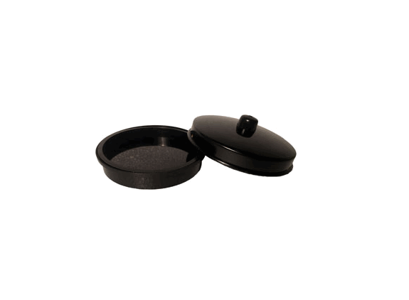 4.25 inch diameter black plastic production pan. Turn and lock the lid into a position that attaches it to the middle layer.
