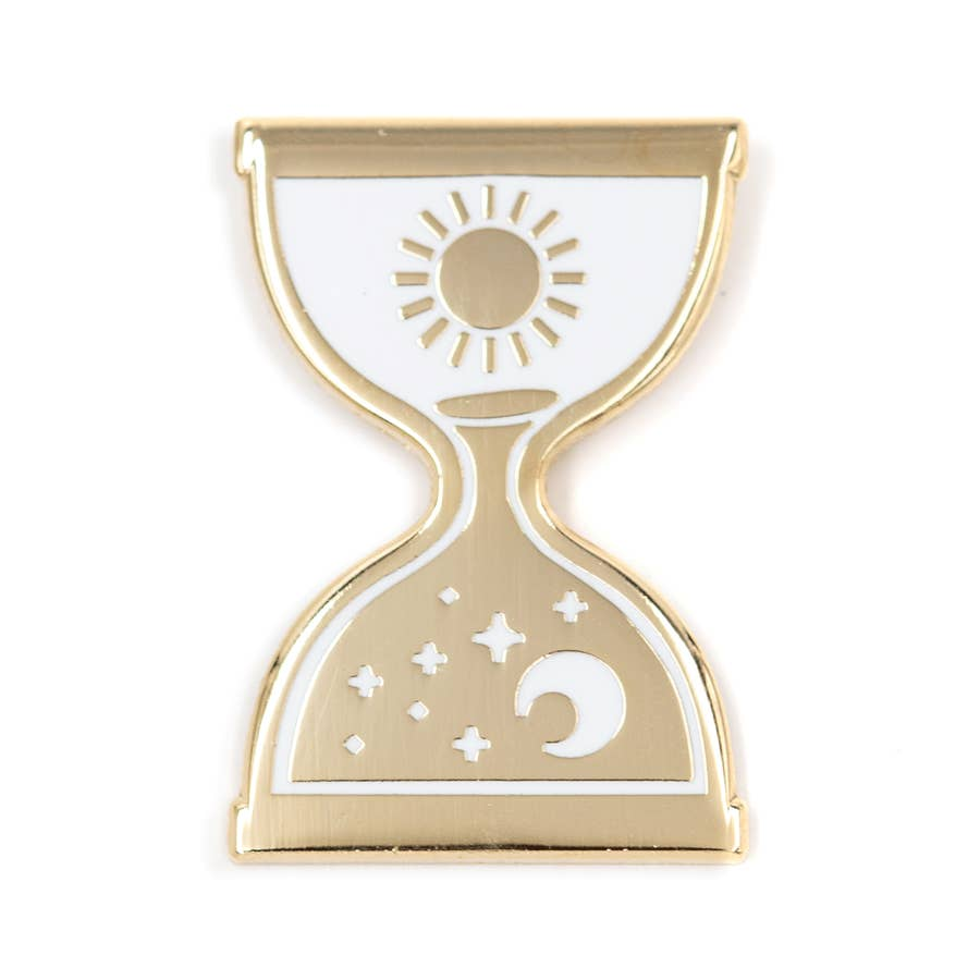 2 inch metallic gold pin in an hourglass shape. 1 inch rubber enclosure. Gold sun design against white background on top. White moon and stars design on the bottom half against a gold background.
