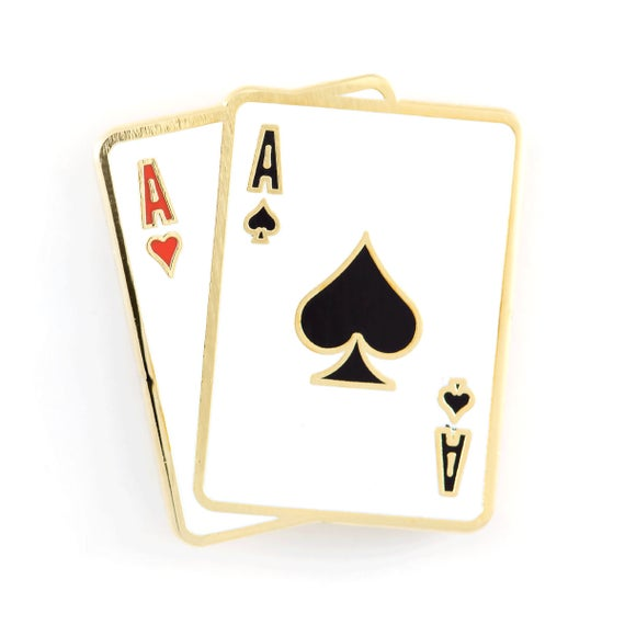"1"" gold pin shaped in a pair of cards. Ace of spades in front of ace of hearts."