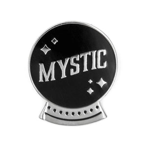 "1 inch metallic silver pin. Crystal ball-shaped in black with ""MYSTIC"" and stars inside."