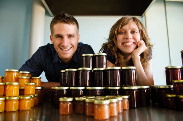 Matt and Clare pose in kitchen with Quince and Apple preserves