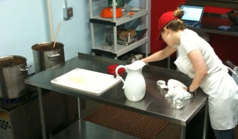 Quince and Apple co-founder Clare Stoner Fehsenfeld cleans up after a production in our first kitchen