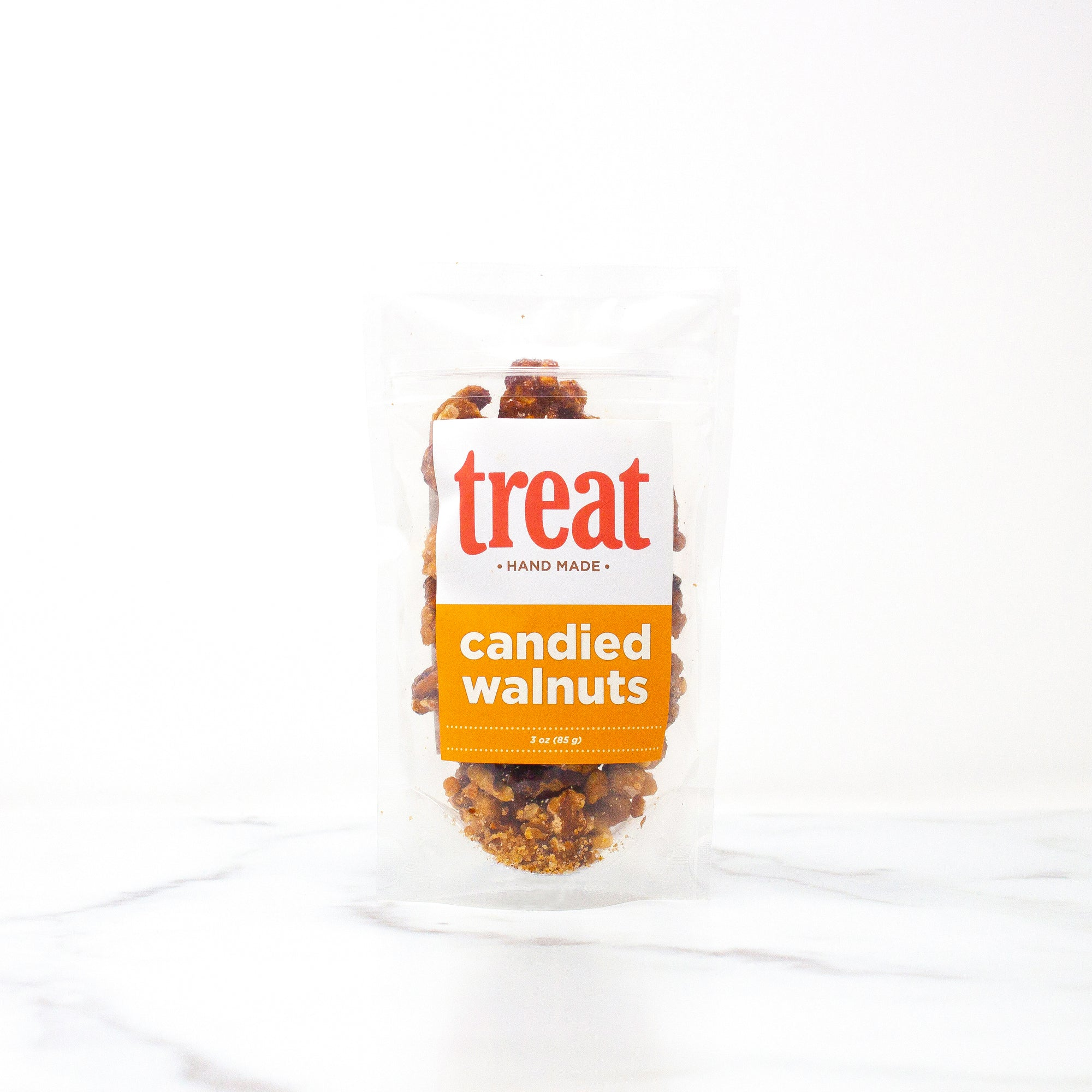 Enjoy this 3 oz bag of candied walnuts from Treat. Made in small batches, our gourmet candied walnuts explode with flavor and are the perfect gift for any season.