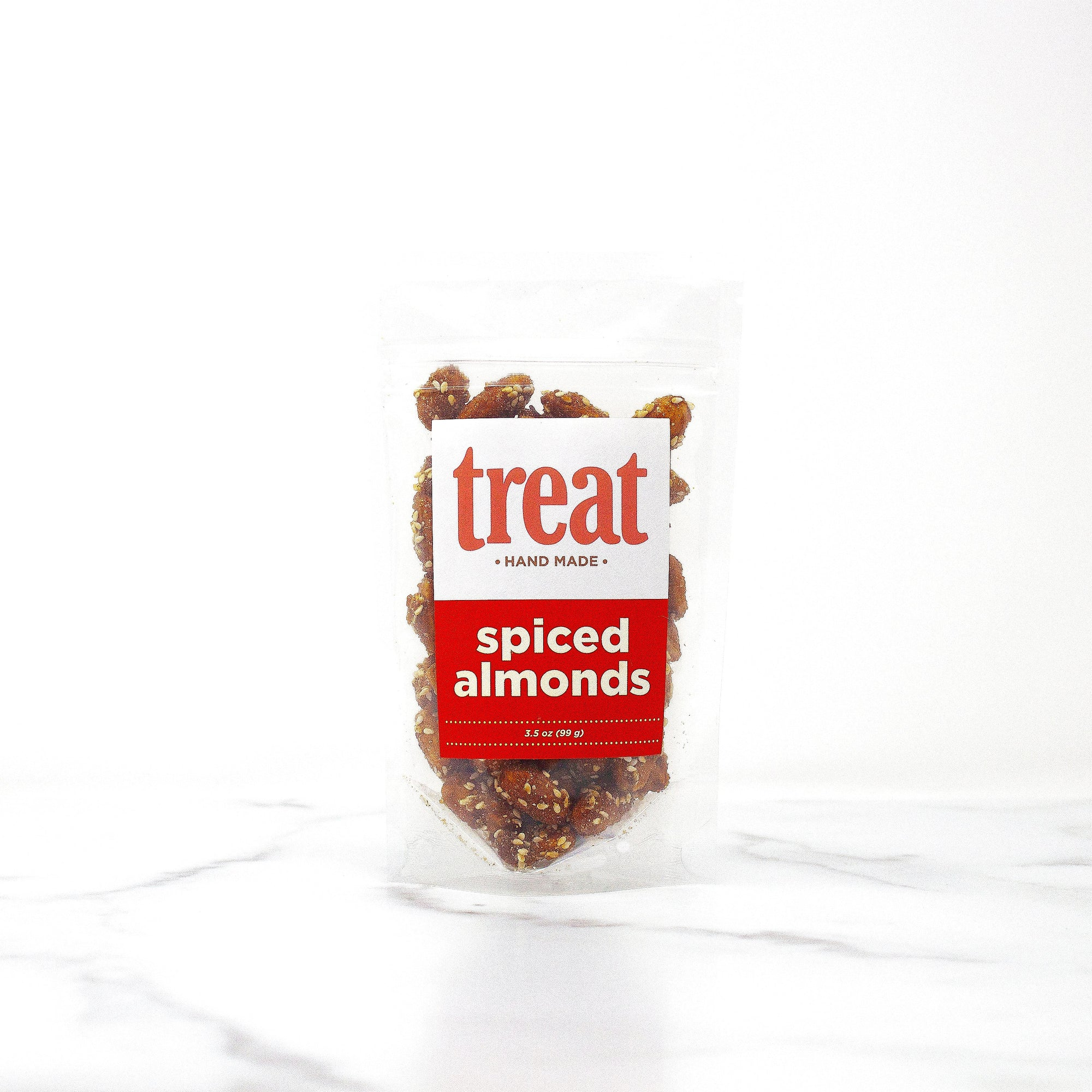 Enjoy this 3 oz bag of spiced almonds from Treat. Made in small batches, our gourmet spiced almonds explode with flavor and are the perfect gift for any season.