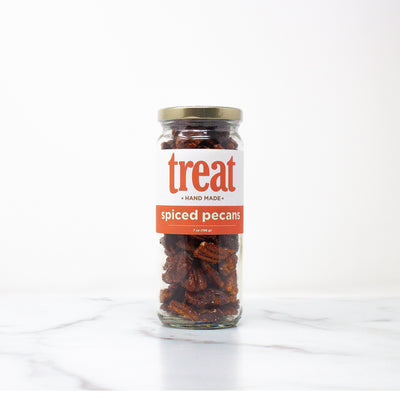 Enjoy our 7 oz spiced pecan jar, made in small batches from Treat. Our gourmet nuts explode with flavor and are the perfect gift for any season.