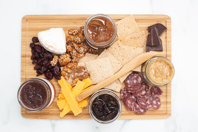An artisan cheese board is easy to make with this gourmet gift box!