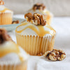 Caramel cupcakes topped with candied walnuts