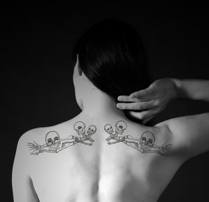 Large Skulls and Bones Mirror Images Left and Right Set Waterproof Temporary Tattoos Lasts 3 to 4 days