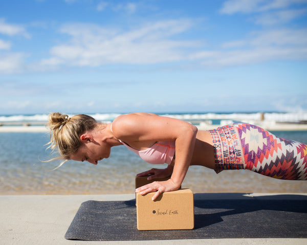Yogi with 2E 'Levitate' natural cork yoga block