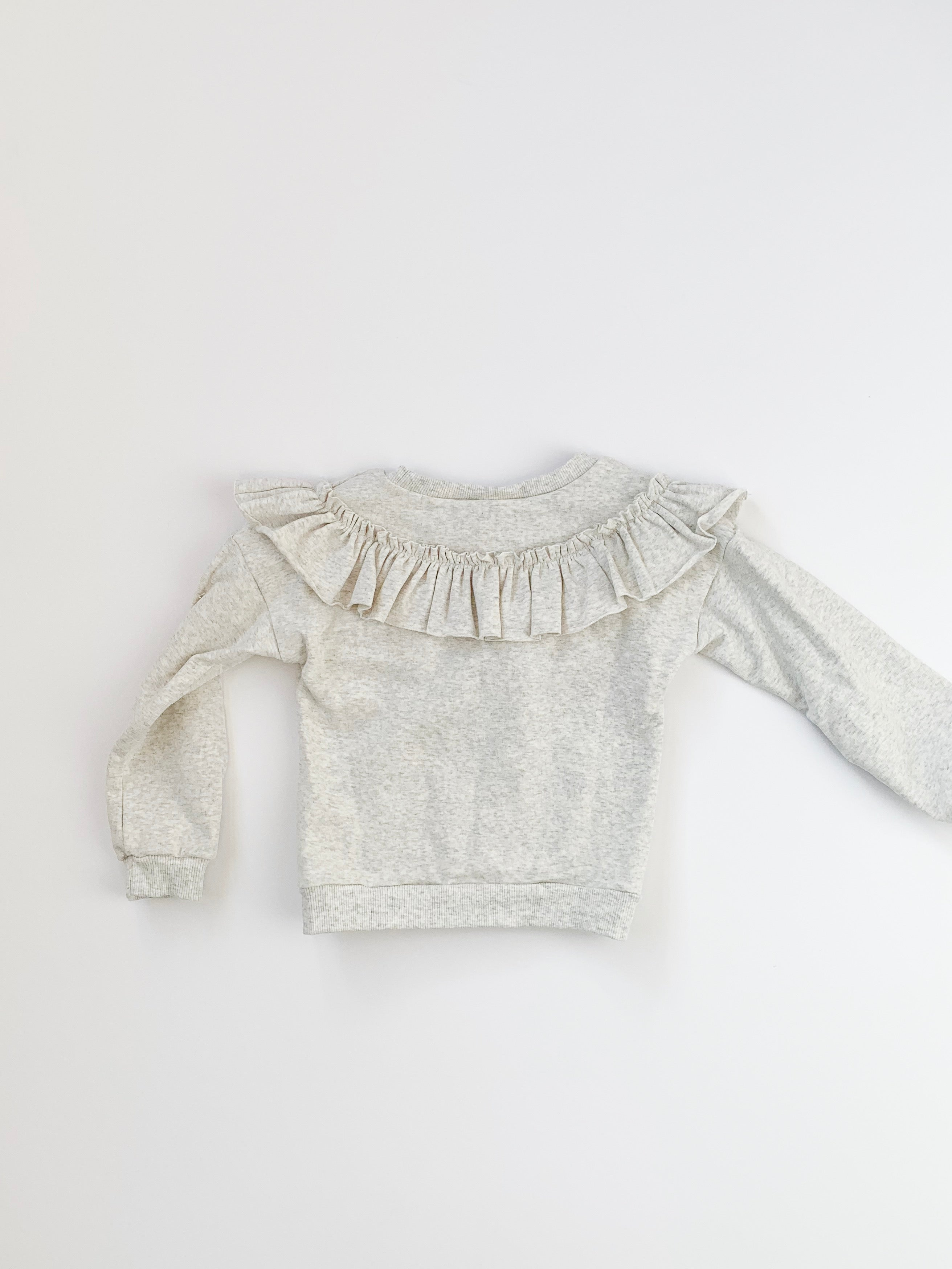ruffle front pullover