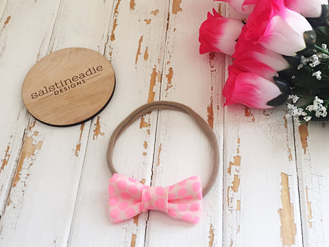 Fluro pink dots bow headband