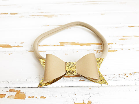 Gold faux leather glitter bow