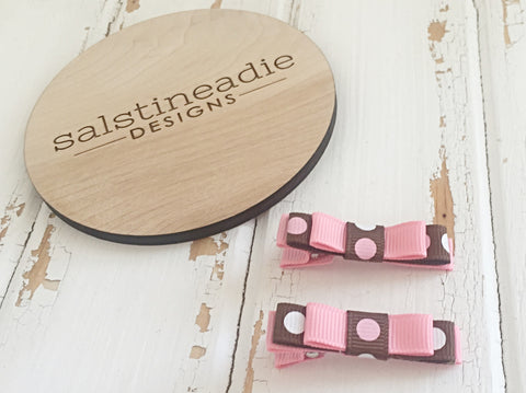 Pastel pink and brown polka dot double bow hair clips