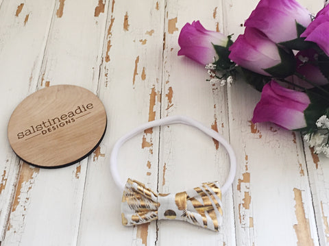 """Tiger"" White and metallic gold bow headband"