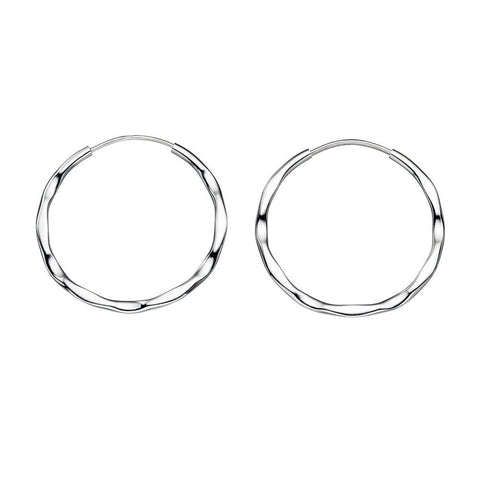 Solid silver textured hoop earrings