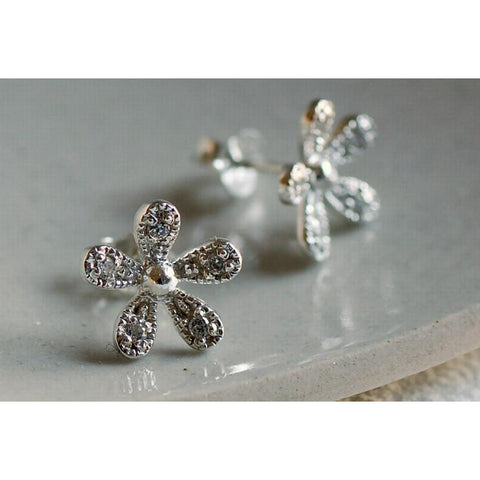 Solid silver daisy earrings