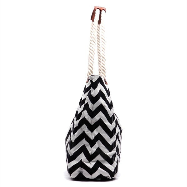 Black and white canvas chevron print, zip top closure tote bag.