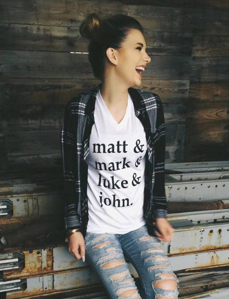 "V-neck printed graphic t-shirt top says ""Matt & Mark & Luke & John"" on the front white shirt and gray shirt"