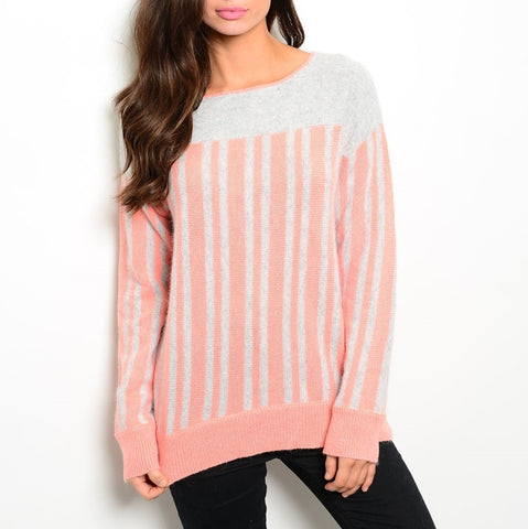 coral and gray cozy knit sweater with a rounded neckline long sleeves ribbed trim