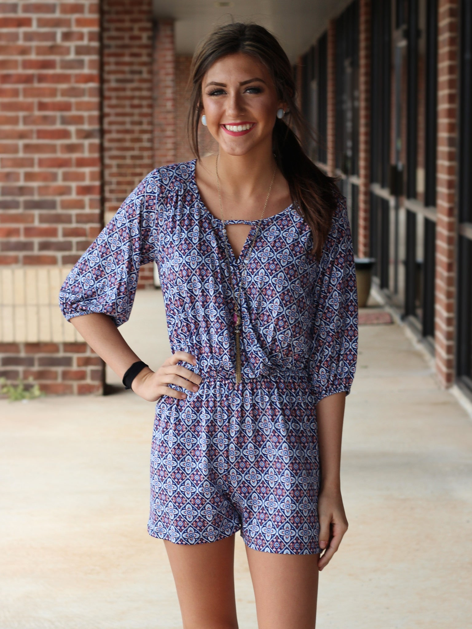 blue criss cross front 3/4 sleeve short romper