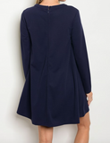 Long Sleeve above the knee navy shift dress with crew neck and neckline cutouts.