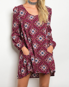Long sleeve multi color print skater dress with a round neckline and pockets
