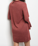 Long sleeve knit shift dress that features a crew neckline and ruffle detailed bell sleeve cuffs