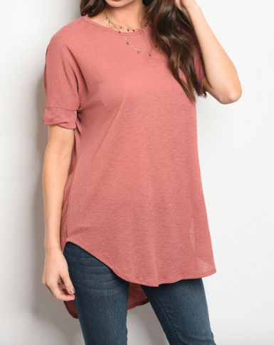 3/4 sleeve relaxed fit pink tunic that features a rounded neckline