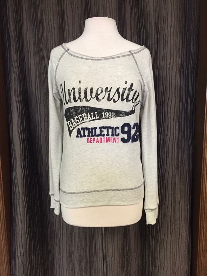 baseball cream and navy sweat shirt