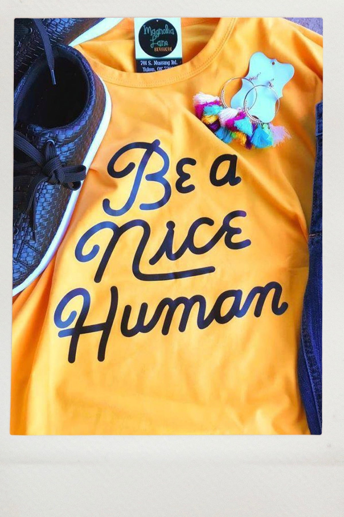"yellow Unisex Fit Graphic Tshirt with words ""Be a nice human"""