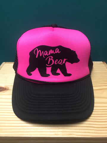 hot pink and black trucker hat with a bear on the front that says Mama Bear