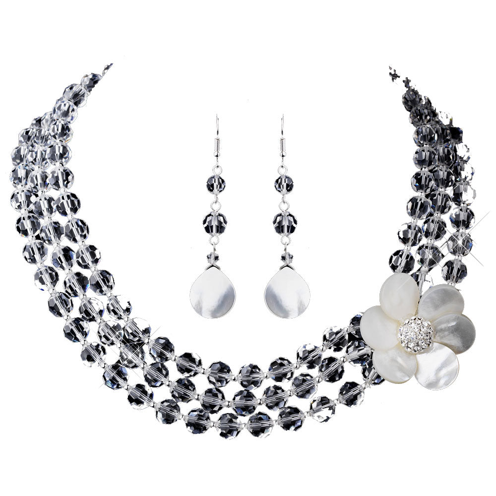 Beautiful and versatile beach wedding necklace set. The clear crystals will sparkle and the effervescent mother of pearl flower echoes the beach or destination theme. It will be $120 for the set.