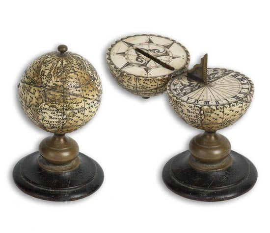 Fine miniature ivory globe which opens to a sundial.