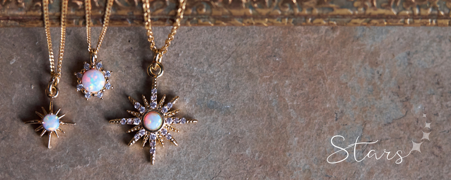 Collection of dainty gold and opal layering star necklaces