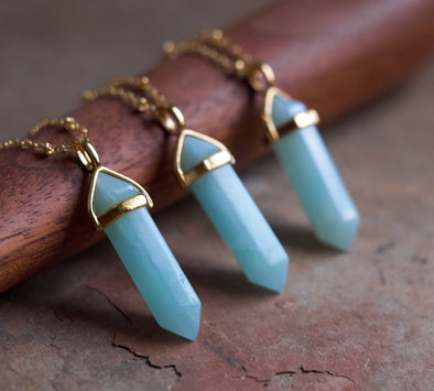 Turquoise and gold gemstone pendant