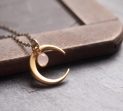 Matte gold crescent moon necklace with delicate moonstone accent
