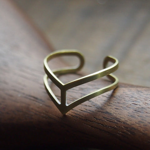 Modern brass arrow ring